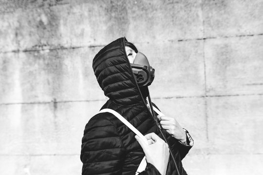 desperate woman with a gas mask looking up