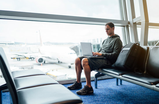 Man sitting with laptop at the airport