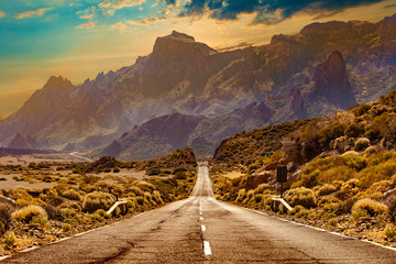 Image related to unexplored road journeys and adventures.Road through the scenic landscape to the destination in Tenerife natural park. Fototapete