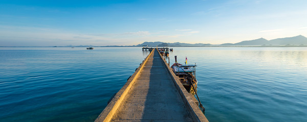 Boat bridge in calm sea in Thailand on the island Koh Mook Wall mural
