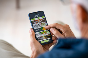 Man using mobile app to order delivery food