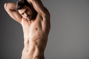 sexy muscular naked young man on grey Wall mural