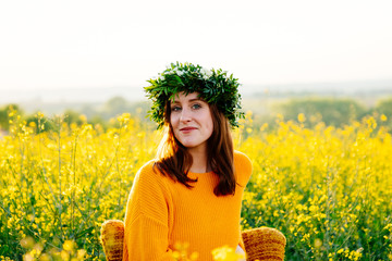 Young woman sitting on a chair in the rape field