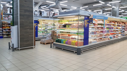 Yogurts on a shelf in a supermarket during the coronavirus epidemic