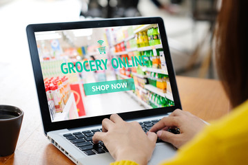 Grocery online shop to order food delivery from supermarket, Woman hands using laptop computer for...