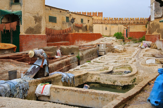 Courtyard with different stone vats with dye for leather in Tannery of Tetouan Medina. Northern Morocco.