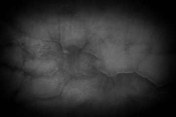 Old crack black concrete wall. Dark cement wall texture and background. Empty interior for design.
