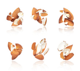 Group of crushed almonds in the air close-up, isolated on a white background