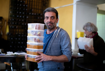 Waiter Bob carries boxes with food inside Restaurant-Bar Steindl in Vienna
