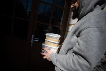 A customer carries food for lunch from Restaurant-Bar Steindl in Vienna