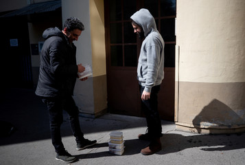 Waiter Bob delivers boxes with food to a customer in Vienna