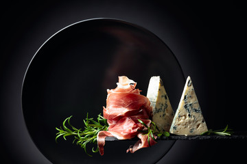 Wall Mural - Prosciutto or spanish jamon with blue cheese and rosemary.