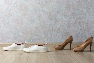 sneakers and shoes on a wooden background. Fashion, beauty and convenience.