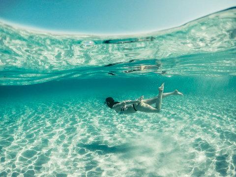 Girl in a bikini diving