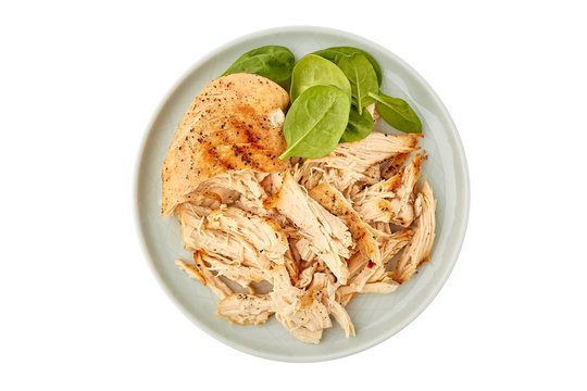 Plate with pulled chicken breast on white