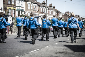 Brass band of young people . View from back .Carnaval parade in Dover, UK, England