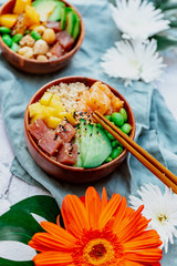 Salmon poke with avocado, seaweed, pickled carrots and cucumber