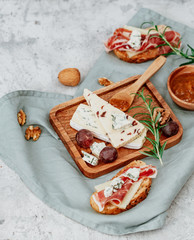 Assortment of cheese on wooden cutting board