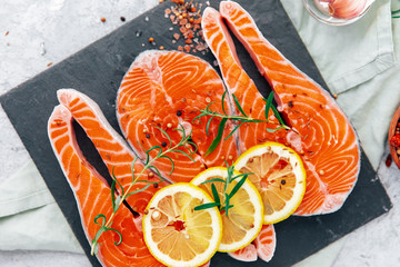 Raw red salmon steaks on a back board. Top view