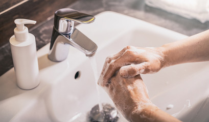 Washing hands with soap and hot water. Prevention coronavirus.