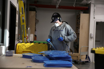 Workers at Bednark produce medical face shields, as the demand for their production rapidly increased