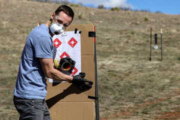 Firearms instructor Joseph Wilkey wears a mask and gloves during a firearms safety class conducted by Level Up Firearms amid fears of the global growth of coronavirus disease (COVID-19) cases, outside Loveland, Colorado