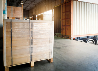 Interior of warehouse, Large pallet shipment boxes, Truck docking load cargo at warehouse, Road freight industry logistics shipping and transport
