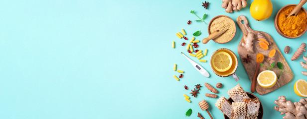Healthcare, flu and cold treatment. Naturopathy concept. Ginger, lemon, honey, pills, drugs,...