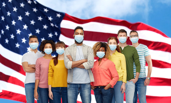 health, safety and pandemic concept - group of people wearing protective medical masks for protection from virus over american flag background