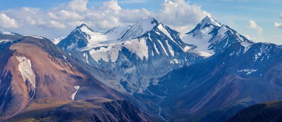 Wall Mural - Mountain landscape, panoramic view. Snow-capped peaks, glaciers. Mountain climbing and mountaineering.