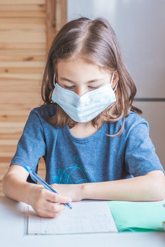 The child is engaged in home schooling. Quarantine at school. Pandemic Covid-19