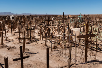 An old cemetery with wooden crosses near the abandoned towm of Pampa Union, in the Atacama Desert, Chile, South America.