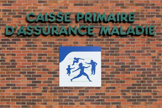 Jassans, France - February 12, 2017: Social security sign on a wall. Illness branch called Assurance Maladie is one of the four branches with retirement, family, work accident in France