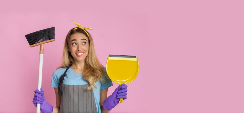 Woman with broom and shovel smiles on pink background