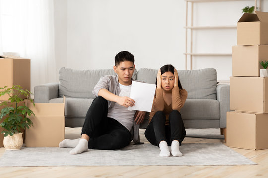 Asian man showing his shocked wife eviction notice