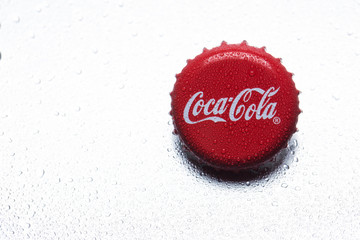 classic cap close-up of Coca-Cola on a white background.