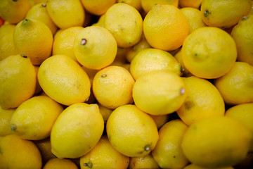 Fototapeta Fresh organic lemons on a market shelf