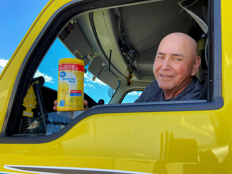Gakin, a trucker from Chamberlain, South Dakota sits in his vehicle and shows the disinfectant wipes he used to clean his hands and credit card to reduce the risk of catching the coronavirus disease (COVID-19) after visiting a truck stop in Las Vegas