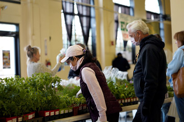 Shoppers examine fresh herbs at Farmers Public Market in Oklahoma City