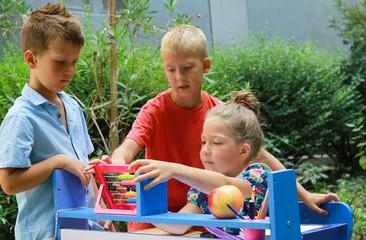 Home -School concept, Education during Coronavirus Quarantine. Brothers and sister doing homework...