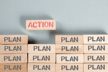 Wooden Blocks with Plan and Action Concept