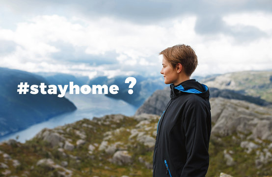 stayhome hashtag on picture with woman traveler