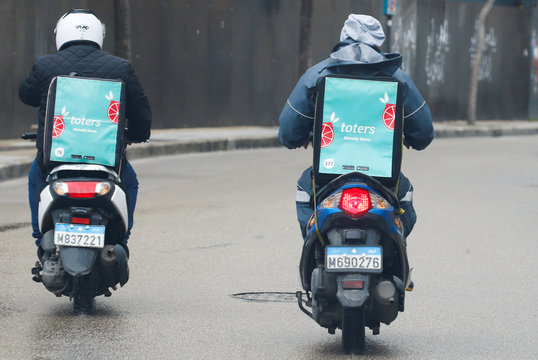 Delivery drivers from the mobile app toters ride on motorcycles, amid the coronavirus disease (COVID-19) outbreak, in Beirut