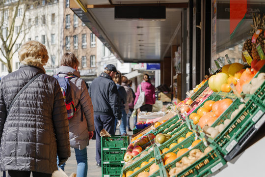 Selected focus, European people queue outside in front of food stall and supermarket during quarantine for COVID-19 virus in Düsseldorf, Germany.