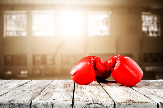 Red boxing gloves on desk and free space for your decoration.