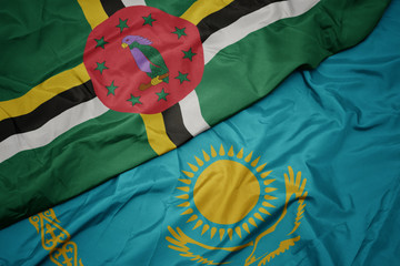 Deurstickers Noord Europa waving colorful flag of kazakhstan and national flag of dominica.