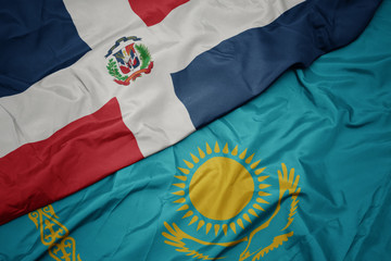 Deurstickers Noord Europa waving colorful flag of kazakhstan and national flag of dominican republic.