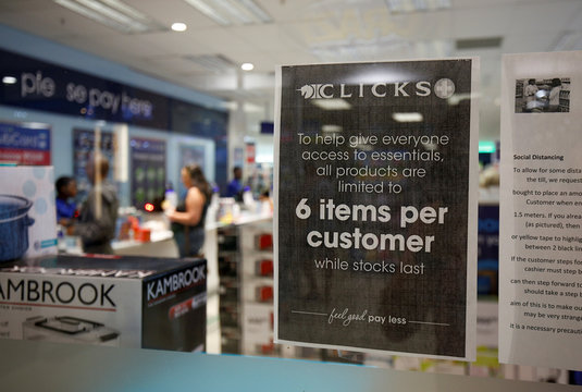 Signs in a pharmacy tell customers of restrictions ahead of the 21st day of a nationwide lockdown in an attempt to contain the coronavirus disease (COVID-19) outbreak in Hillcrest