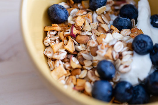 macro shot of a breakfast cup with cereals, yogurt and berries