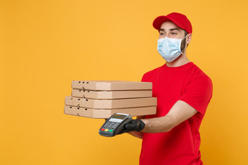 Delivery man employee in red cap blank t-shirt uniform mask gloves give food order pizza boxes...